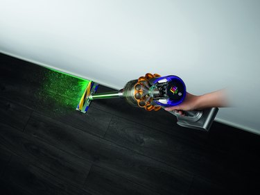 dyson v15 detect cleaning floor with green laser