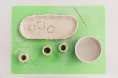 Attach the cylinders to the clay platter.