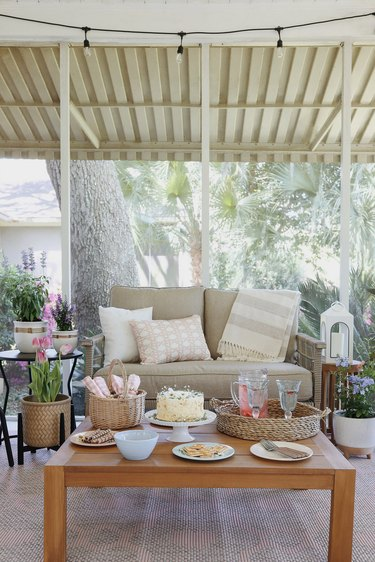Cottagecore spring patio styled with pastel decor and cottage garden flowers