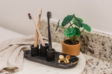 Air-dry clay toothbrush holder on bathroom vanity