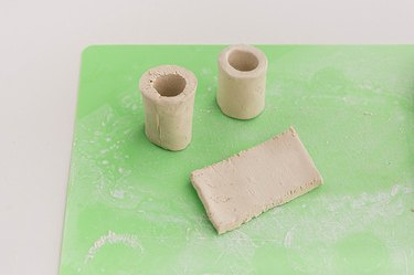 Turn the clay strips into cylinders.