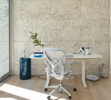 desk space with white furniture and blue side table