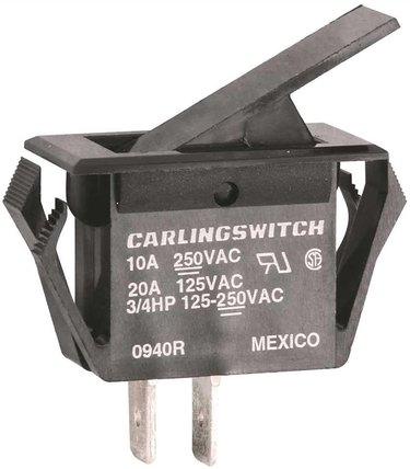 A close up of a furnace door safety switch part