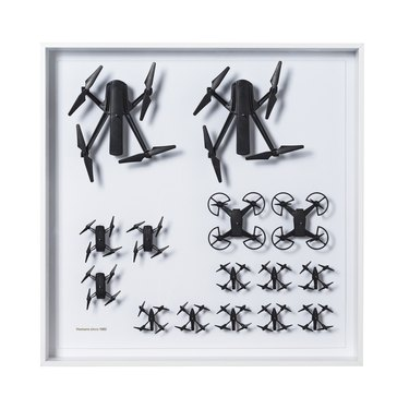 framed wall art with black drone-like figures