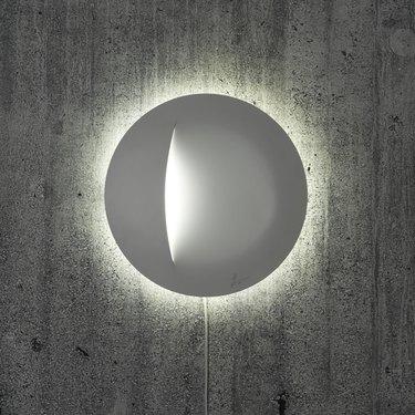 circular wall light glowing white