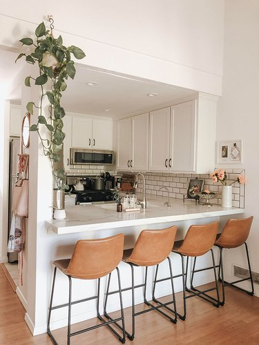 modern kitchen with white subway tile and dark grout