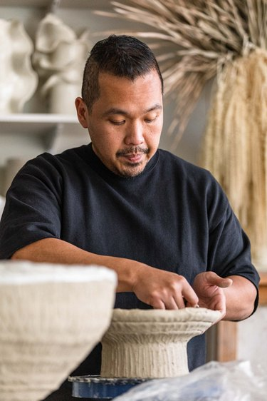 Dodie Sy at work in his studio
