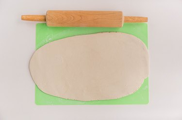 Roll clay out flat until it's about 1/4-inch thick.