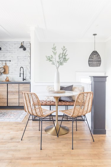 modern eat-in kitchen with bistro table and rattan chairs