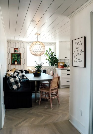 white eat-in kitchen with cozy banquette and throw pillows