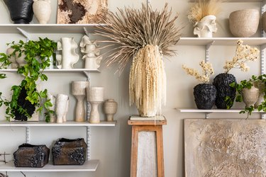 Wall shelving with plants and pottery