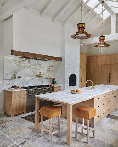 modern eat-in kitchen with eating area placed at one end of kitchen island