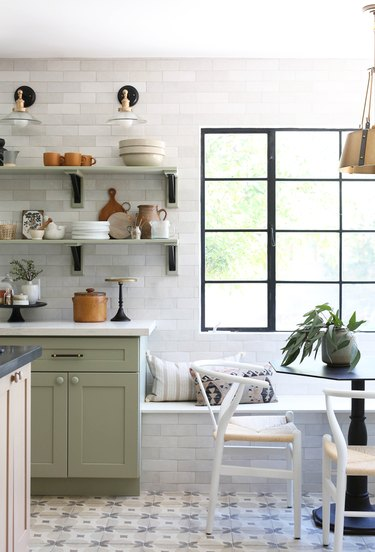 sage eat-in kitchen with white subway tile wall