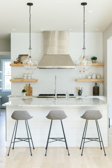 modern kitchen with open shelves and industrial lighting