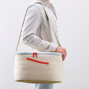 person with cooler bag around their shoulder