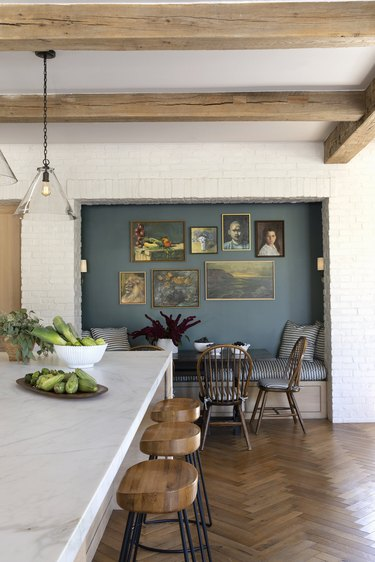 white eat-in kitchen with banquette and blue accent wall