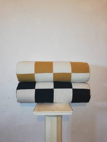 two checkered pillows in a stack