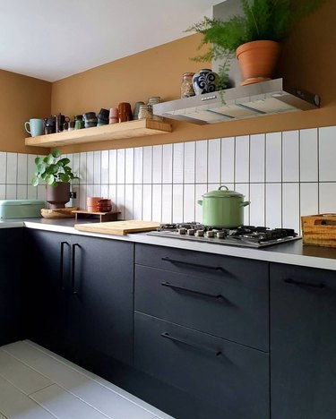 modern kitchen with black cabinets and black hardware
