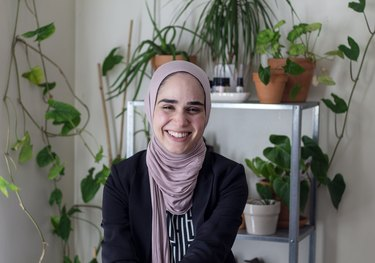 Summar Saad in her home with plants in the background