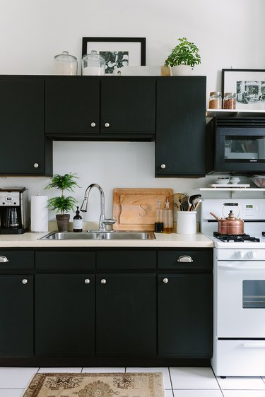 black kitchen cabinets in apartment