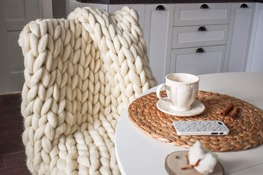 chunky knit blanket on chair