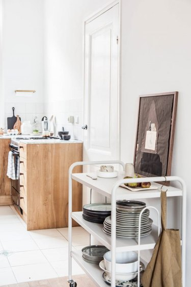 small kitchen with rolling cart for extra storage