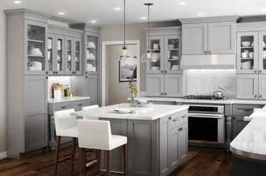 How to Install Crown Molding on Cabinets in kitchen with gray cabinets and dark wood floor