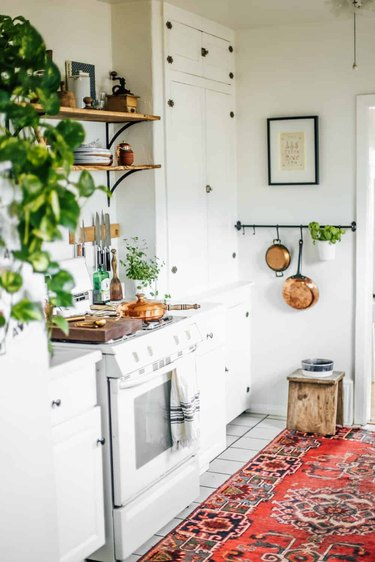 small kitchen with area rug on floor