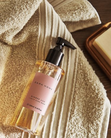 liquid hand soap bottle on towel