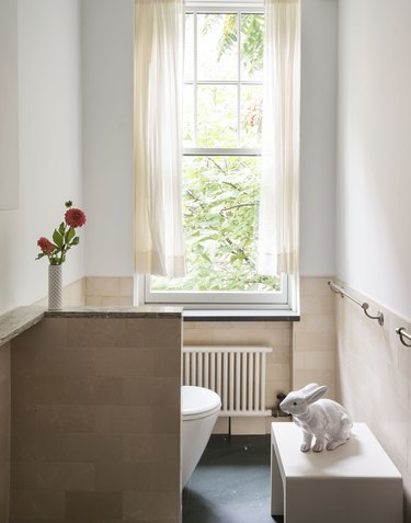 The Novogratz bathroom with window