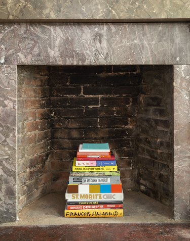 The Novogratz firebox detail with book display