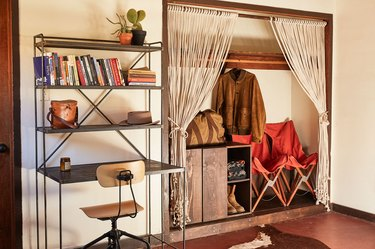 desert style home office with industrial desk and macrame closet curtains