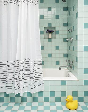 The Novogratz bathroom with aqua mosaic tile