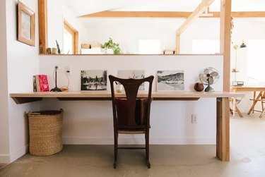 white desert style home office with wooden details and built-in desk