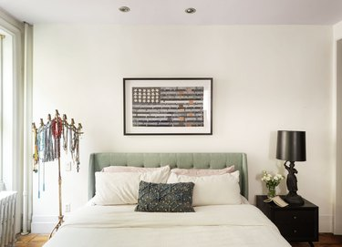 The Novogratz bedroom with upholstered headboard