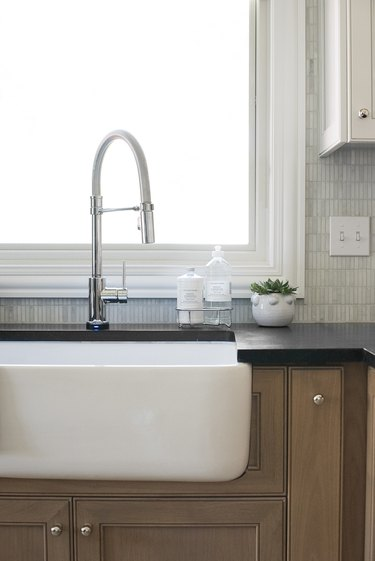 Soapstone kitchen countertop with white apron front sink