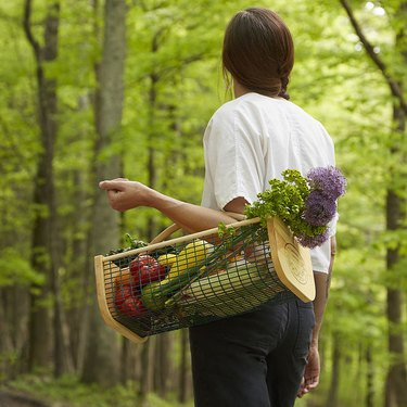 woman with garden basket on her arm
