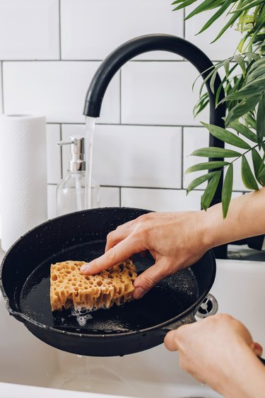 Wash the skillet with soap and water