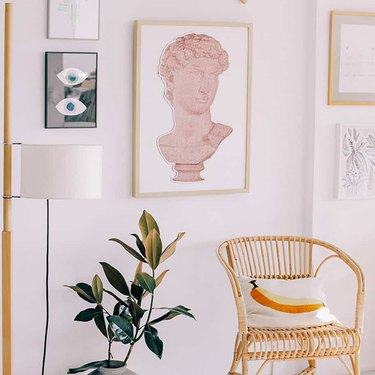 gallery wall with art and accent chair