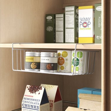 Pantry shelves with under shelf basket.