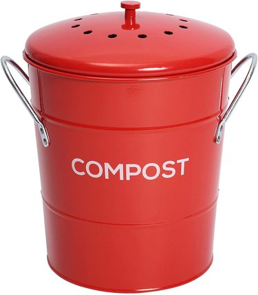 red stainless steel compost bin with charcoal filter