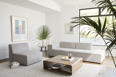 living room with off-white couch and chair and wood coffee table