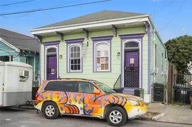 Crescent City Cat Club exterior and car