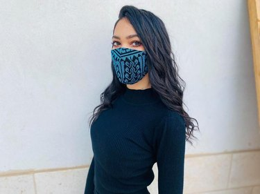person with blue mask and black shirt