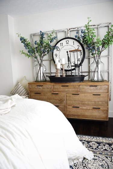 farmhouse bedroom with rustic dresser