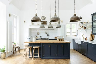 white and blue farmhouse kitchen with reclaimed metal lights