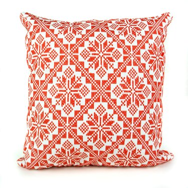 red and white patterned pillow
