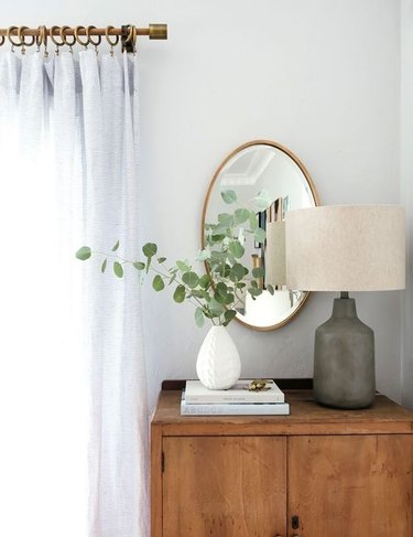 farmhouse bedroom with eucalyptus in vase