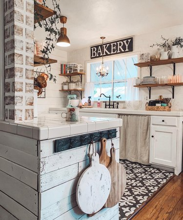 farmhouse kitchen with bakery sign and copper semi-flush mount light