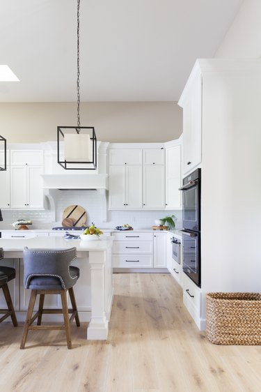 white farmhouse kitchen with geometric pendant lights